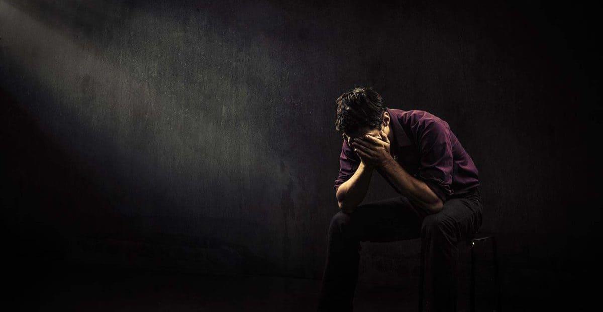 Sad man in a empty room