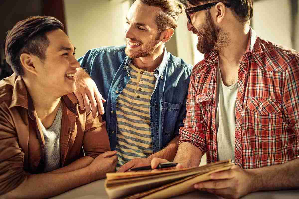 Smiling guys having friendly conversation