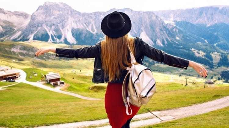 amazing-traveling-experience-image-beautiful-stylish-woman-posing-back-looking-breathtaking-mountains-view-trip-italian-dolomites-hipster-girl-enjoying-adventures_cropped-1.jpg