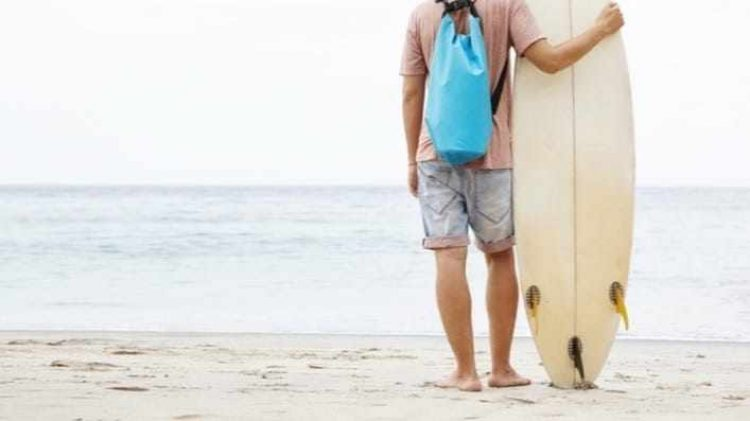 back-shot-young-barefooted-caucasian-surfer-standing-sandy-beach-leaning-his-surfboard-admiring-beauty-power-ocean-front-him_cropped-4.jpg