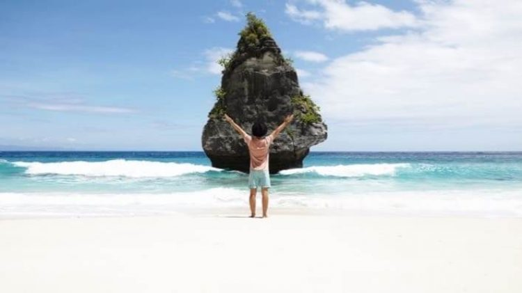 back-view-man-front-rocky-island-with-tropical-vegetation-admiring-wonderful-view-standing-beach-with-azure-ocean-water-blue-sky-horizon_cropped-7.jpg
