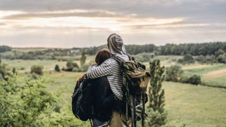 back-view-young-couple-with-backpacks-man-woman-embraced-watching-countryside-landscape_cropped-12.jpg