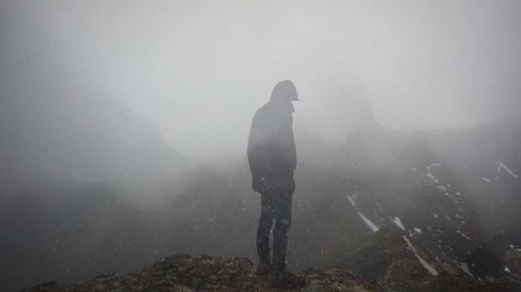 cool-man-standing-edge-foggy-mountain_cropped-17.jpg
