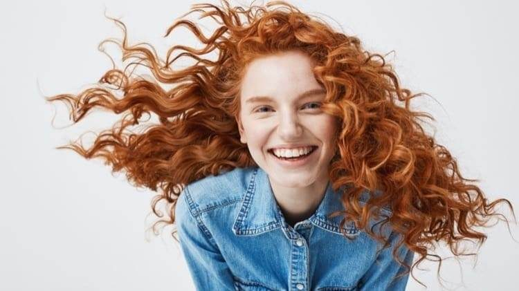 portrait-beautiful-cheerful-redhead-woman-with-flying-curly-hair-smiling-laughing_cropped-35.jpg
