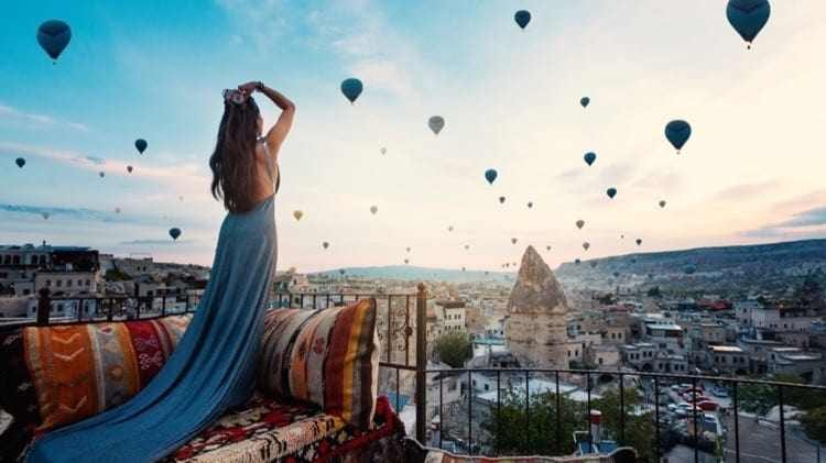 young-beautiful-woman-wearing-elegant-long-dress-front-cappadocia-landscape-sunshine-with-balloons-air-turkey_cropped-56.jpg